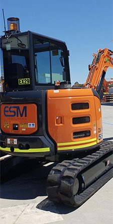 Hitachi excavator on display in the ESM yard ready for deployment.