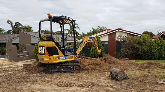 A CAT mini excavator working on a home in the Pilbara.