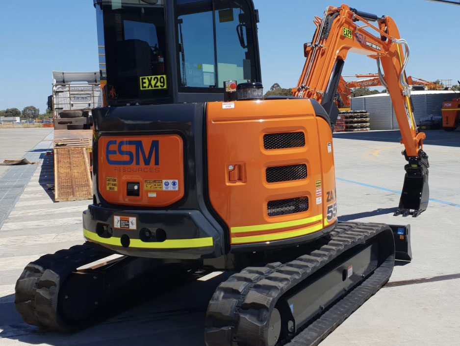 An enclosed mini-excavator for hire at ESM resources.