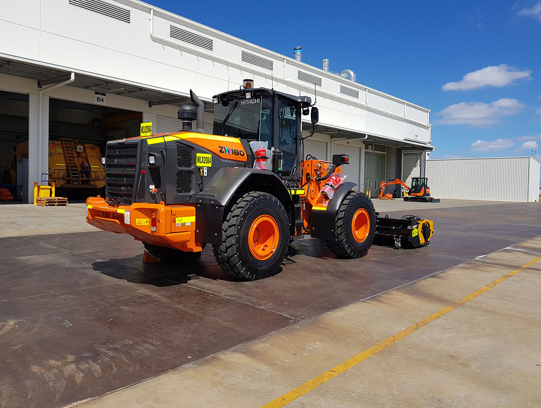 A loader with an attachment fitted ready for hire.