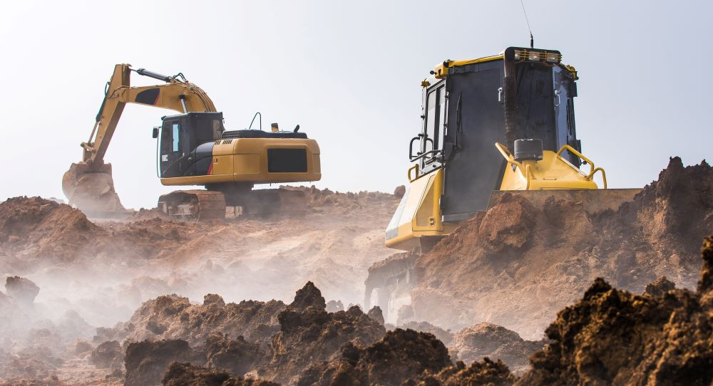 Machines excavating the soil from the beginning of the construction work